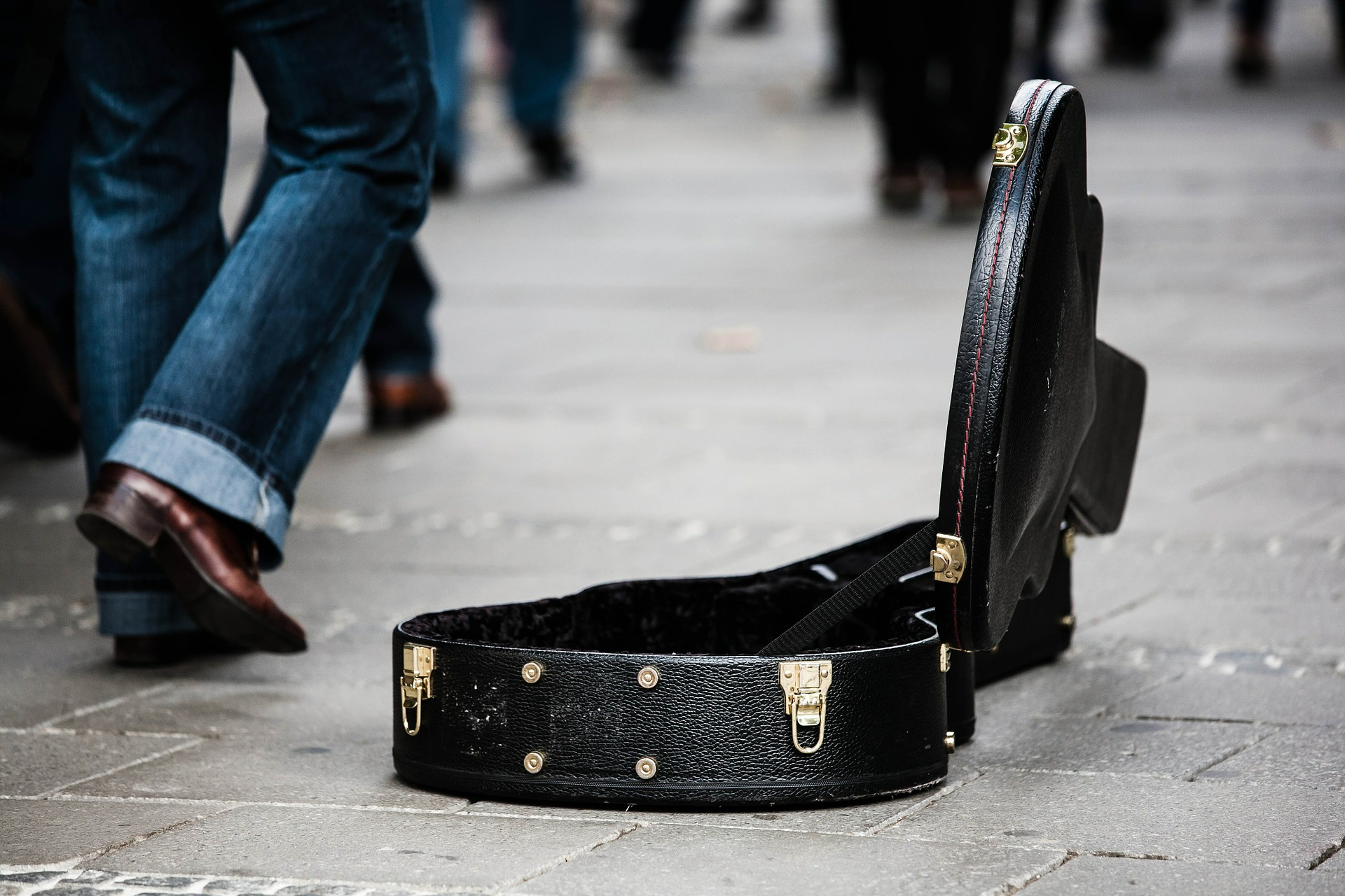 Guitar Case walking by - Lesson Pros